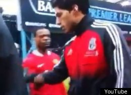 Luis Suarez rejects Patrice Evra's attempt at a handshake on Feb. 10, 2012.