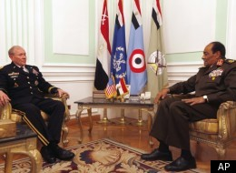 U.S. Chairman of the Joint Chiefs of Staff, Gen. Martin Dempsey, left, meets with Field Marshal Mohamed Hussein Tantawi, head of Egypt's ruling military council, right, at the Ministry of Defense in Cairo, Egypt, Saturday, Feb. 11, 2012. (AP)