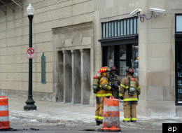 Firefighters at the scene of a Sunday explosion in the sewer under Detroit's Orchestra Hall.