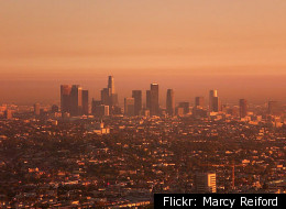 Downtown Los Angeles skyline enveloped in fog. Photo via Flickr: Marcy Reiford.