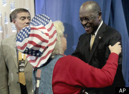 FILE: Former Republican presidential candidate Herman Cain greets Ann Sullivan of Goldsboro, N.C., before speaking to the Southern Republican Leadership Conference Thursday, Jan. 19, 2012, in Charleston, S.C.