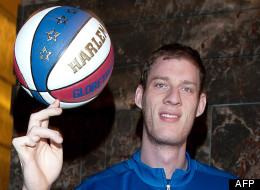 Gentle giant: 'Tiny' Sturgess shows off his ball skills