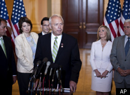 Rep. John Kline, R-Minn., center, accompanied by fellow Republican House members, speaks on Capitol Hill in Washington, Tuesday, Aug. 10, 2010, following a caucus.
