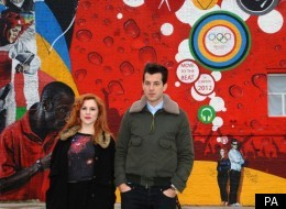 Mark Ronson and Katy B pose by the Olympic Beat Wall