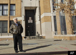 In this Dec. 1, 2011 file photo, Bronx Household of Faith co-pastor Robert Hall poses for a portrait in front of P.S. 15 in the Bronx borough of New York. Hall's congregation finds itself among others who have been scrounging for cheap space in New York City as they prepare to be evicted, on constitutional grounds, from rooms they've been renting at public schools. (AP Photo/Mary Altaffer, File)