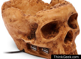This resin skull holds four USB ports and allows a person to do the soliloquy from Hamlet.