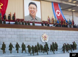 Senior North Korean military members approach an area where new North Korean leader Kim Jong Un and other military and political leaders stand at Kumsusan Memorial Palace in Pyongyang before reviewing a parade of thousands of soldiers and commemorating the 70th birthday of the late Kim Jong Il on Thursday, Feb. 16, 2012. (AP)