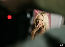 Adult-film star Jenna Jameson poses for photographers after unveiling her new ad for the People for the Ethical Treatment for Animals (PETA) during Mercedes Benz fashion week in Culver City, Calif., on Monday, March 10, 2008. (AP Photo/Matt Sayles)