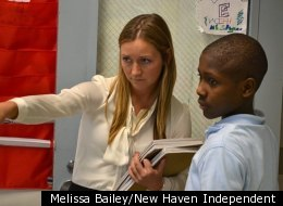 Wexler/Grant School teacher Kaitlyn Shorrock, a Teach For America corps member, gives a 7th grader a parting instruction as he leaves class Thursday.