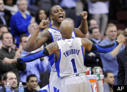 Seton Hall's Herb Pope celebrates with Jordan Theodore (1) during the second half of an NCAA college basketball game against Georgetown Tuesday, Feb. 21, 2012, in Newark, N.J. Seton Hall defeated Georgetown 73-55. (AP Photo/Bill Kostroun)