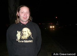 Eddie Free, wearing a V is for Voluntary shirt featuring the image of anarchist Lysander Spooner.