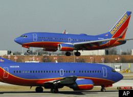On Feb. 9, 2012, a Southwest Airlines Boeing 737 waits to take off at Chicago's Midway Airport as another lands. Southwest Airlines has been a huge beneficiary of the rise in the number of super-commuters in Texas. Southwest Airlines flies 25 flights per day between Houston and Dallas, according to Bloomberg News.