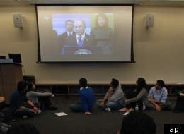 Students watch statements by New York City Mayor Michael Bloomberg during a round table discussion at the Islamic Center at New York University Friday, Feb. 24, 2012 in New York. The New York Police Department targeted Muslim mosques with tactics normally reserved for criminal organizations, according to newly obtained police documents that showed police collecting the license plates of worshippers, monitoring them on surveillance cameras and cataloging sermons through a network of informants. T