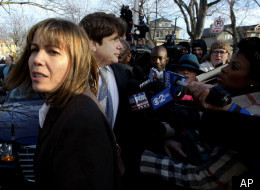 Former Illinois Gov. Rod Blagojevich, right, returns home with his wife Patti in Chicago, Wednesday, Dec. 7, 2011, after he was sentenced by Judge James Zagel to 14 years in prison for his convictions on 18 corruption counts, including trying to to auction off President Barack Obama's old Senate seat. (AP Photo/Charles Rex Arbogast)
