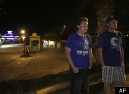 In this Thursday, Feb. 9, 2012 photo, Zach, left, and Ronald Montgomery stand near the motel they live in Clermont, Fla. The gas station behind them is one of the few places to buy goods within walking distance of their motel. Here in Lake County the number of homeless students has skyrocketed, from 122 in 2005 to more than 2,600 this school year. It's the largest increase in hard hit Florida and echoes the rising numbers seen nationwide as well.