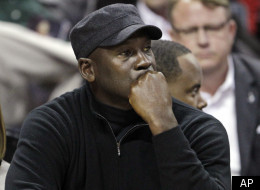 Charlotte Bobcats owner Michael Jordan looks on during the first half of an NBA basketball game between the Bobcats and the Chicago Bulls in Charlotte, N.C., Friday, Feb. 10, 2012. (AP Photo/Chuck Burton)