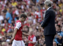 Jack Wilshere hobbles off last July in the Emirates Cup
