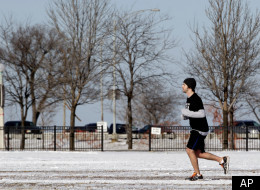 A runner jogs along Chicago's lakefront last month. Illinois's winter was its third warmest on record.