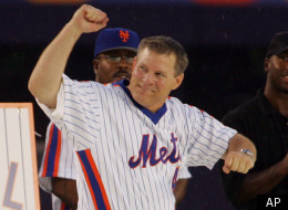 Lenny Dykstra, a member of the 1986 World Champion New York Mets team, reacts to fans during a pre-game ceremony to honor the 20th anniversary of the Mets 1986 team before the New York Mets played a baseball game against the Colorado Rockies, Saturday, Aug. 19, 2006, at Shea Stadium in New York. (AP Photo/Ed Betz)