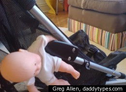 A Maclaren stroller with a doll caught in the closing mechanism, created by Greg Allen of <a href=