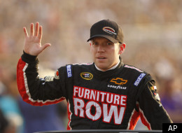Regan Smith waves to the crowd prior to the start of the NASCAR Sprint Cup race at the Richmond International Raceway in Richmond, Va., Saturday, April 30, 2011. (AP Photo/Steve Helber)