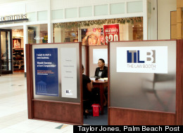 Attorney Melva Rozier meets with a client at the Law Booth, located inside the Boynton Beach Mall.