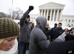 Anti-abortion protesters pray outside the U.S. Supreme Court during the annual