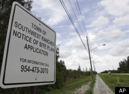In this photo taken Tuesday, July 26, 2011, a sign is posted at the site for a proposed detention center to be built in Southwest Ranches, Fla.