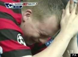 A Manchester City fan weeps after Swansea take the lead at the Liberty Stadium