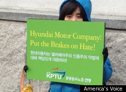 Protester stands outside Hyundai shareholder meeting in Seoul.