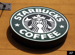 This Jan. 3, 2012 file photo shows the Starbucks Coffee logo in Mountain View, Calif. Starbucks Corp. is pushing beyond coffee with the opening of its first Evolution Fresh Inc. juice store, the company said Monday, March 19, 2012. ( AP Photo/Paul Sakuma, File)