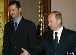 Russian President Vladimir Putin (R) receives Syrian President Bashar al-Assad (L) during their meeting in Moscow's Kremlin, January 25, 2005. Russia and Syria have reached a deal on restructuring debt owed by Syria left over from the Soviet era, the Syrian and Russian presidents announced after Kremlin talks. (Photo by Salah Malkawi/ Getty Images)
