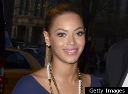 Beyonce wows in a tight blue Victoria Beckham dress.