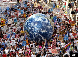 A crowd fills a Manhattan avenue during a protest march leading up to the Republican National Convention site sponsored by United for Peace and Justice, in New York, Sunday, Aug. 29, 2004, the day before the Republican National Convention (AP Photo/Joe Cavaretta )