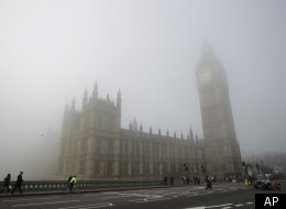 Fog shrouds the clock tower which houses the 'Big Ben' bell of the Palace of Westminster, as Westminster Bridge stands at right in London, Thursday, March 15, 2012. (AP)