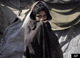 An Afghan girl from Helmand province stands outside of a tent in a refugee camp in Kabul, Afghanistan, Tuesday, Feb. 7, 2012. (AP)