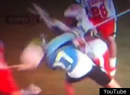 Virginia's Pat Harbeson delivered an illegal hit on Johns Hopkins' Rob Guida.