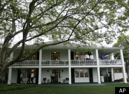 Patrons wait at the clubhouse before a practice round for the 2008 Masters golf tournament at the Augusta National Golf Club in Augusta, Ga., Monday, April 7, 2008. The Masters tournament begins on Thursday, April 10. (AP Photo/Rob Carr)