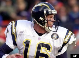 San Diego Chargers quarterback Ryan Leaf rolls out of the pocket as he looks for a receiver in the first quarter against the Denver Broncos in Denver, Sunday, Nov. 19, 2000. Leaf passed for 311 yards in the Chargers 38-37 loss to the Broncos. (AP Photo/Kevin Higley)