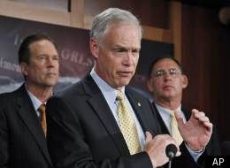 Sen. Ron Johnson (center) discusses the budget at the Capitol.