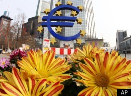 The European Union is considering a financial transactions tax in order to pay for the 2008 bank bailouts. In this photo, flowers are seen near the Euro sculpture in front of the European Central Bank in Frankfurt, Germany, Wednesday, March 7, 2012.