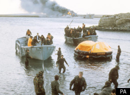 Survivors of the attack on RFA Sir Galahad coming ashore in life rafts at San Carlos Bay
