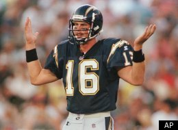 FILE: San Diego Chargers' quarterback Ryan Leaf tries to figure out what play is being called against the San Francisco 49ers Aug. 8, 1998.