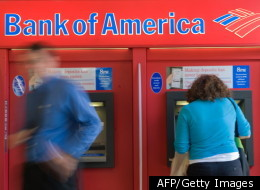 Too big to fail? People use a Bank of America automatic teller machine in Washington on September 15, 2008, the day it announced it was buying Merrill Lynch.