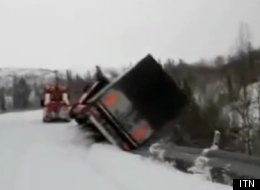 This is the moment a lorry got dangerously close to the edge of a snow-covered mountain road in Norway.