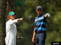 Henrik Stenson consults caddie Oliver O'Reilly during round 1 at the Masters.