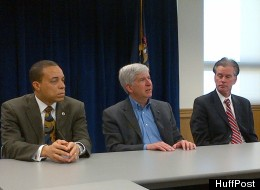 Michigan Gov. Rick Snyder (center) with Treasurer Andy Dillon (right) and Director of Urban Initiatives Harvey Hollins (left) in a media briefing in Detroit April 5, 2012.