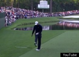 Tiger Woods kicks his club in frustration during the Masters at Augusta National.