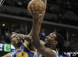 Denver Nuggets' Kenneth Faried, right, shoots against Golden State Warriors' Jeremy Tyler in the first period of their NBA game in Denver on Monday, April 9, 2012. Denver beat Golden State 123-84.(AP Photo/Joe Mahoney)