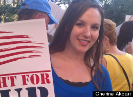 Cherine Akbari protests teacher layoffs in Florida's Broward County.